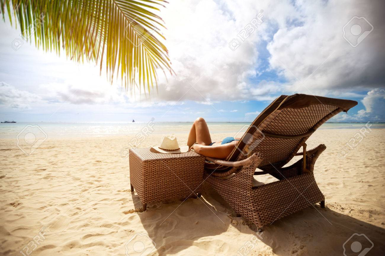 Relax on sunbeds on peaceful beach, holiday and vacation - 58086598