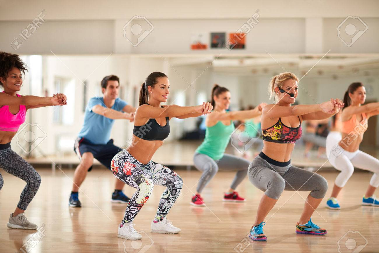 Fitness group doing exercises for shaping breech on fitness class Banque d'images - 58189338