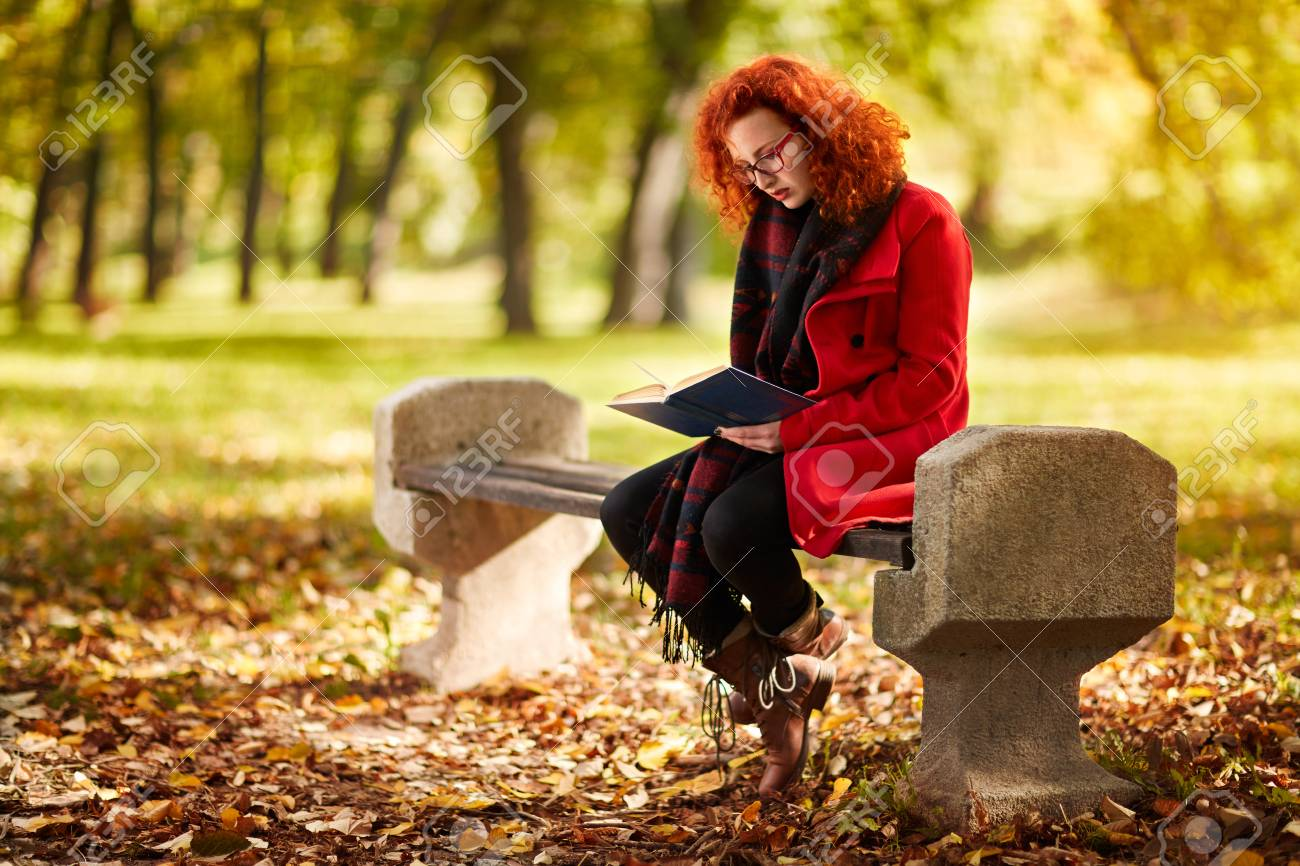 Redhead Girl Read Book In Nature In October