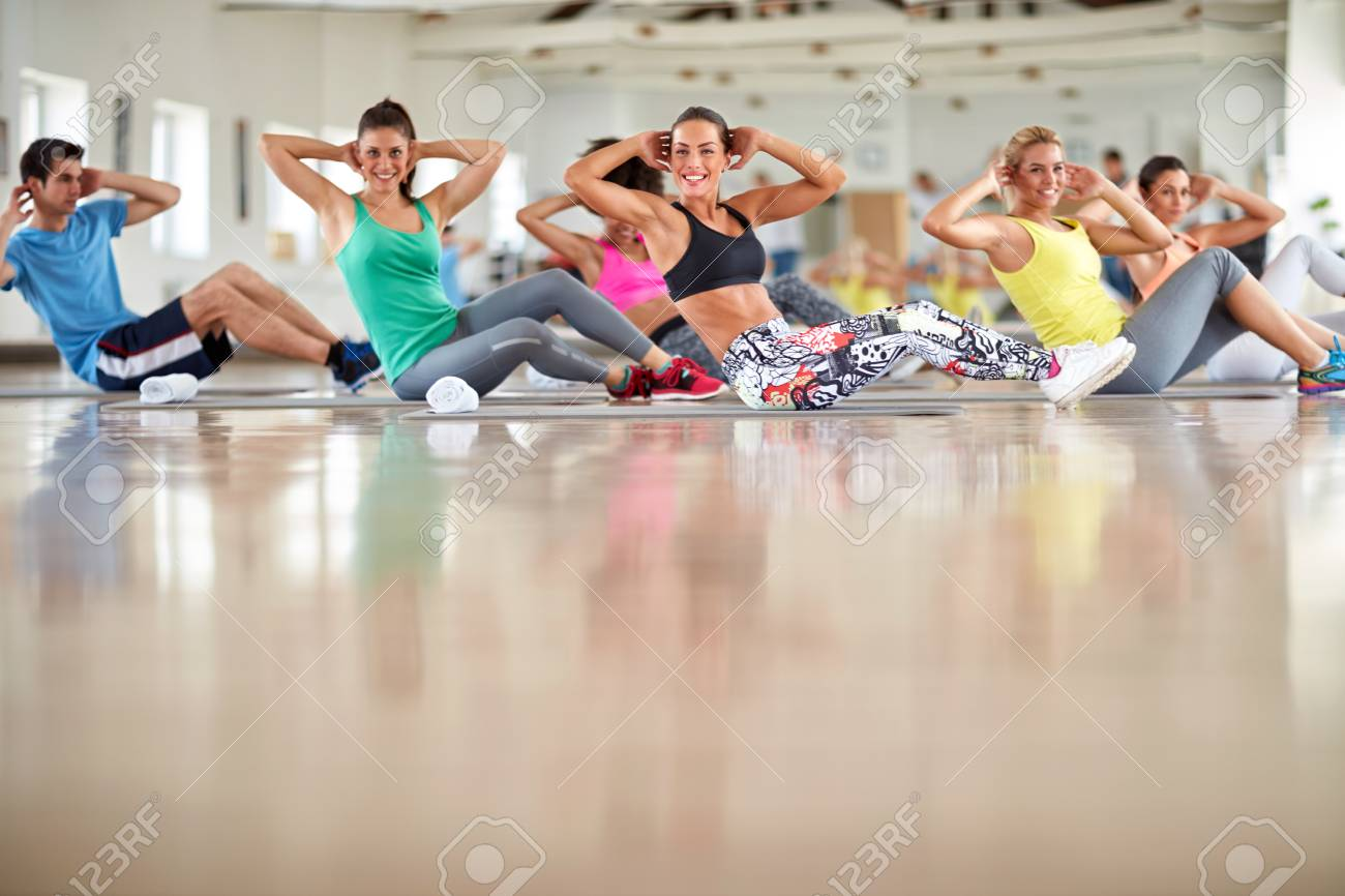 Group of young people on training at gym - 86178206