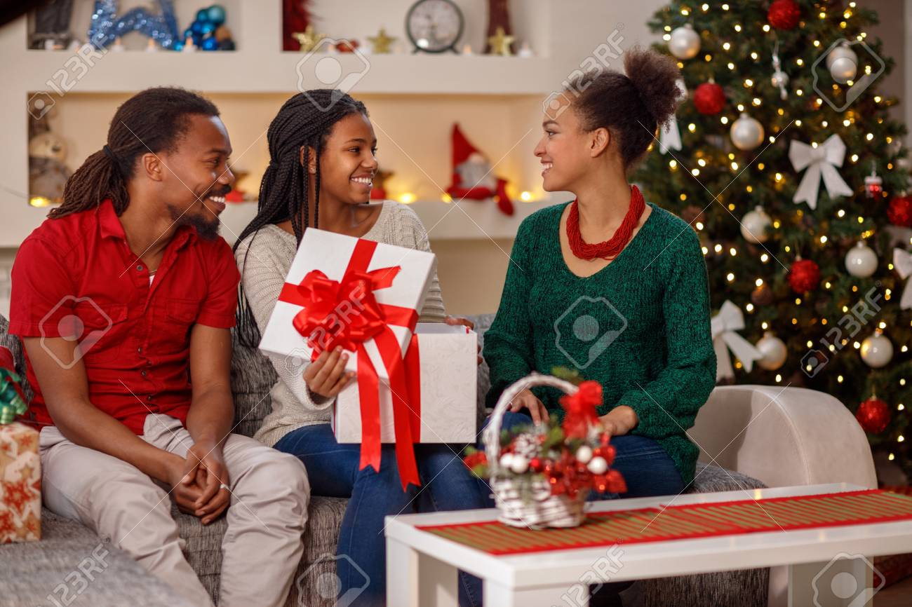 Family Christmas Gifts.Family Christmas Holidays And People Concept Exchanging Christmas