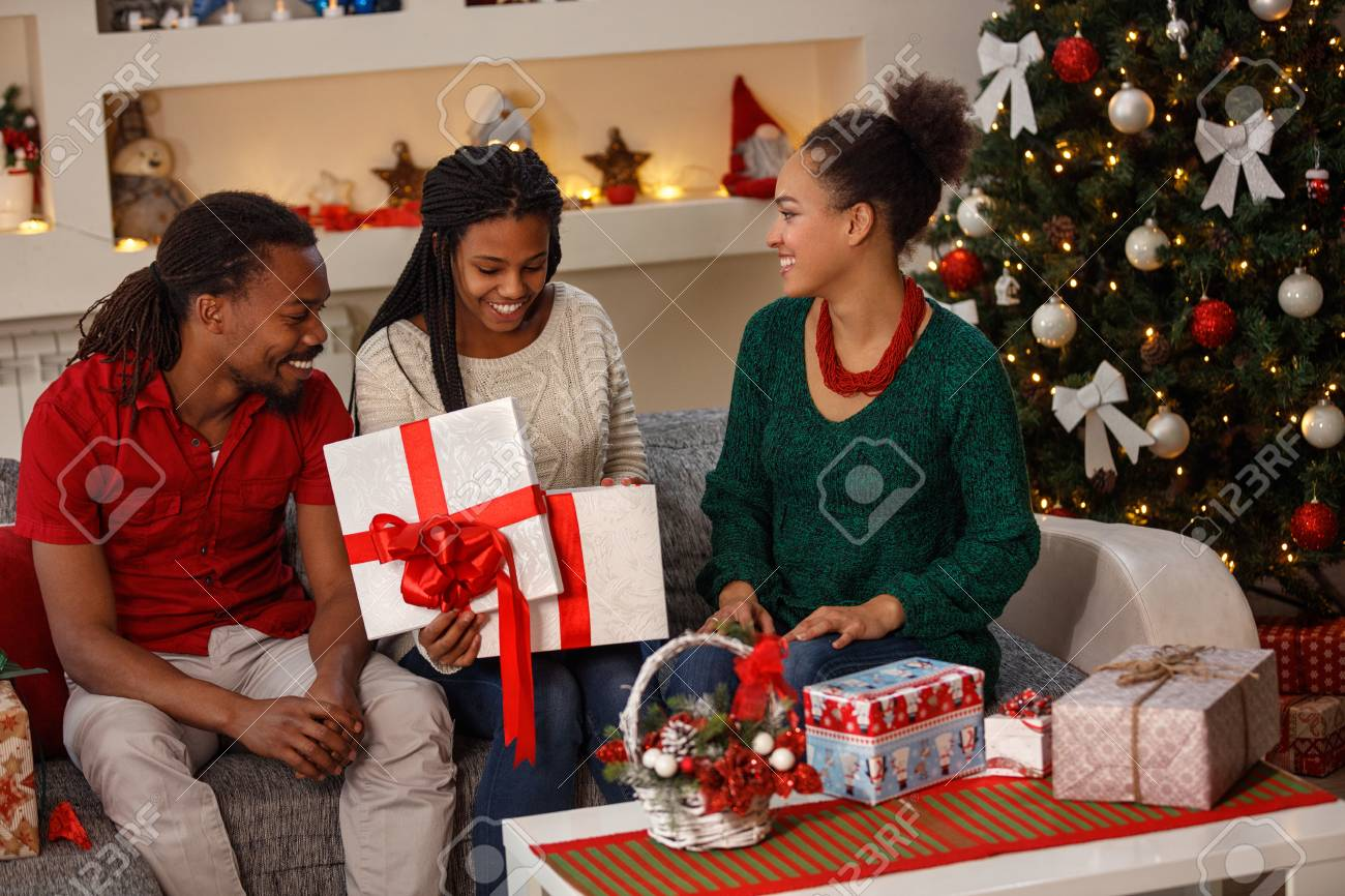 Surprised Smiling Girl Looking Christmas Gift From Parents Stock ...