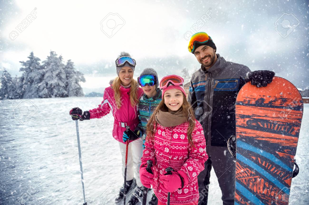 smiling family enjoying winter sports and vacation on snow in mountains - 88960898