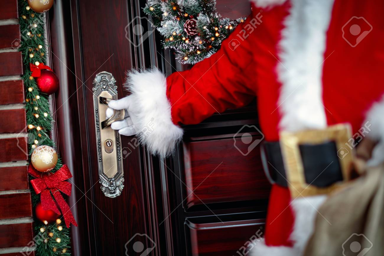 Claus Porto Nederland.Gloved Hands Of Santa Claus Open The Door Close Up