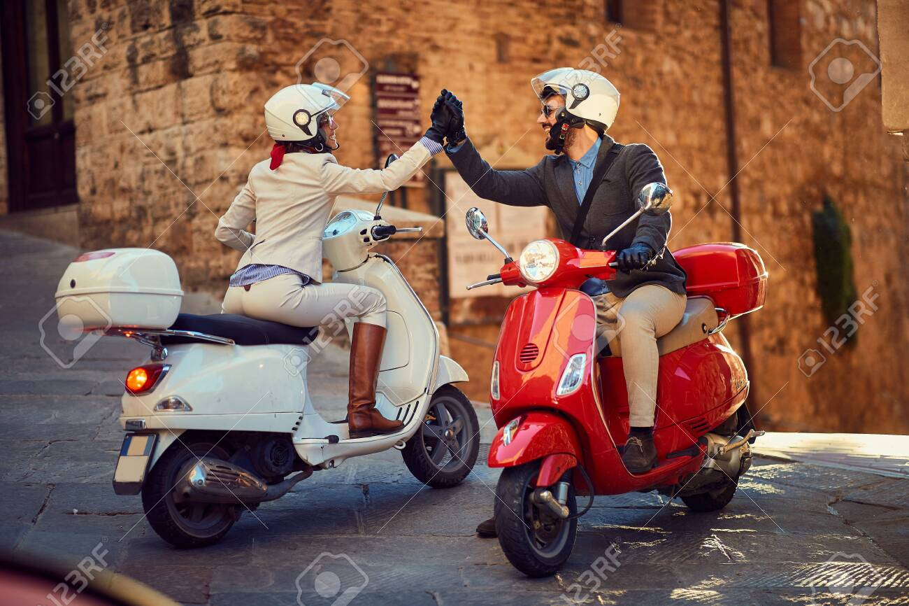 Young Italian Couple On Vespa Scooter Bikers Couple Stock Photo Picture And Royalty Free Image Image 131082178