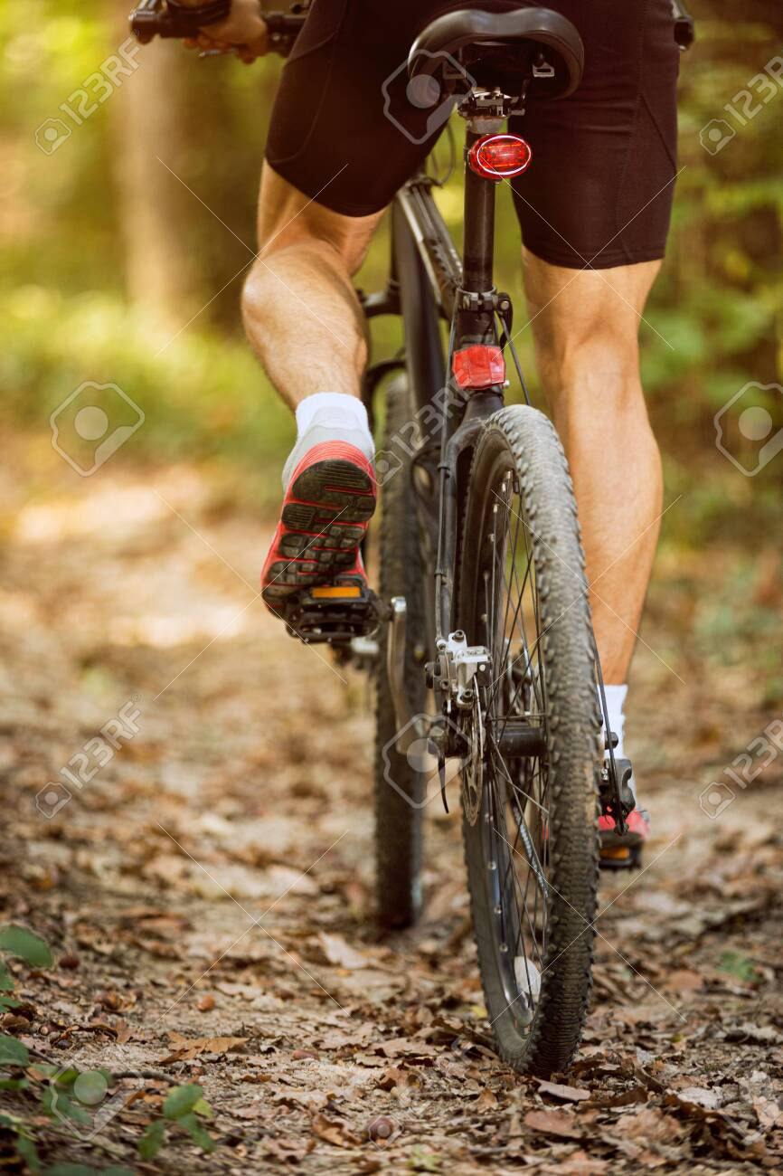 mountain bike man riding on outdoor trail in nature - 141250267
