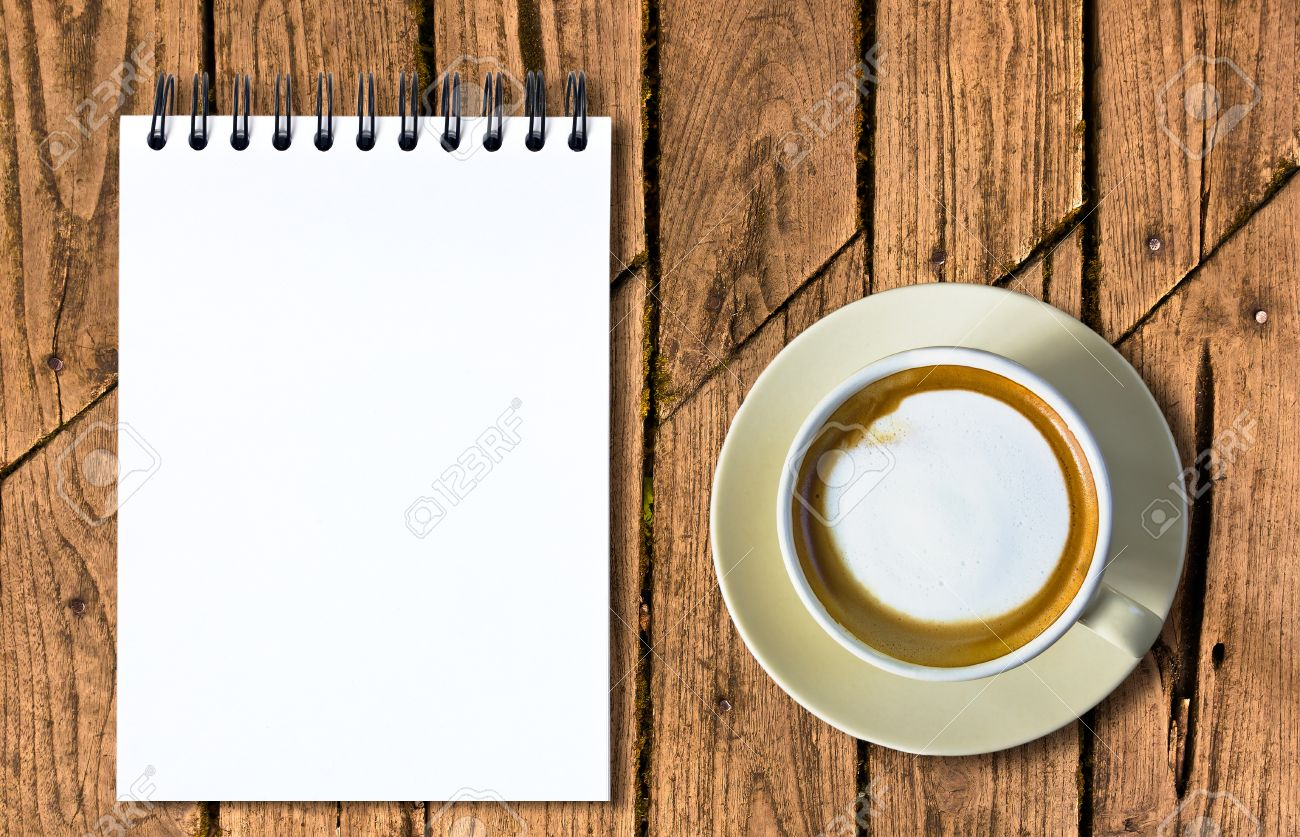 Coffee and white sketch book on old wood table Stock Photo - 11875633