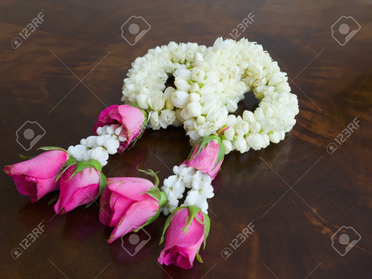 Garland Of Jasmine Flowers On The Table Stock Photo Picture And