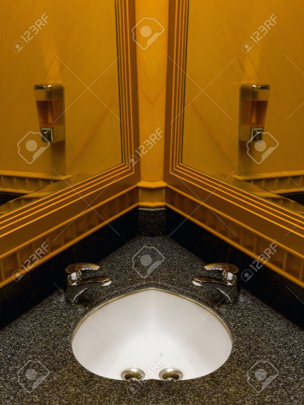 bathroom with double faucet hand wash basin heart shape Stock Photo - 12734843