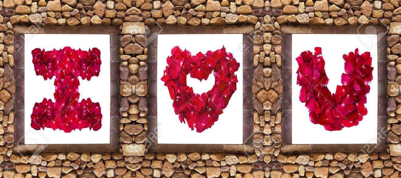 i love you word made from red rose petals in stone frame stock photo 18320355