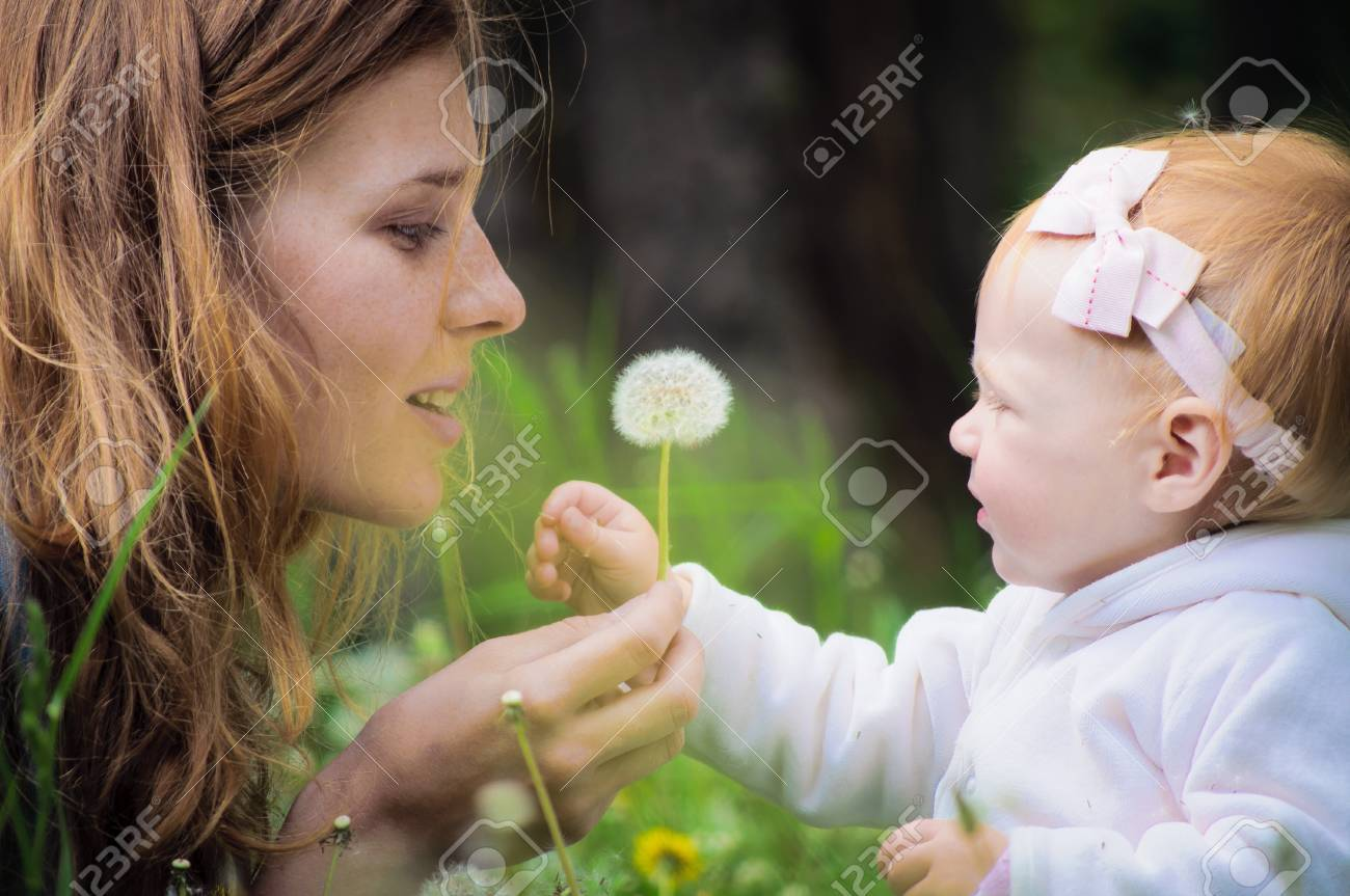 Young mother with little baby at the park Stock Photo - 10132212