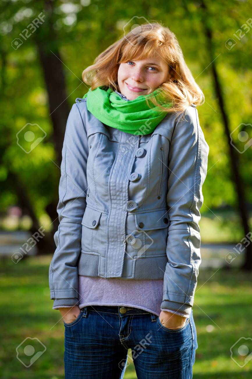 Smiling happy young woman at the park Stock Photo - 11596497
