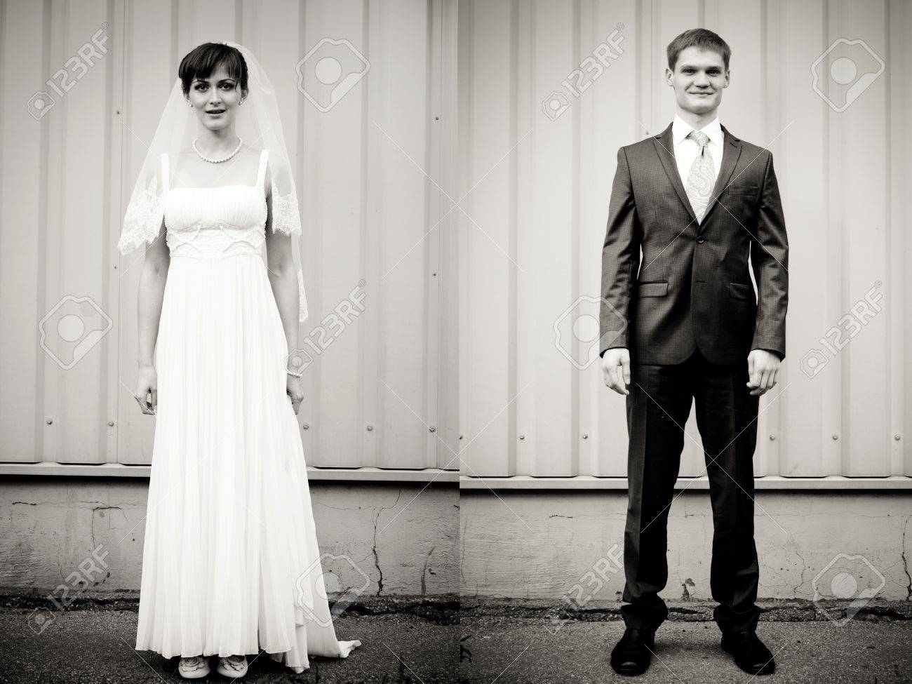 Full Lenght portrait of bride and groom standing against wall Stock Photo - 11792853