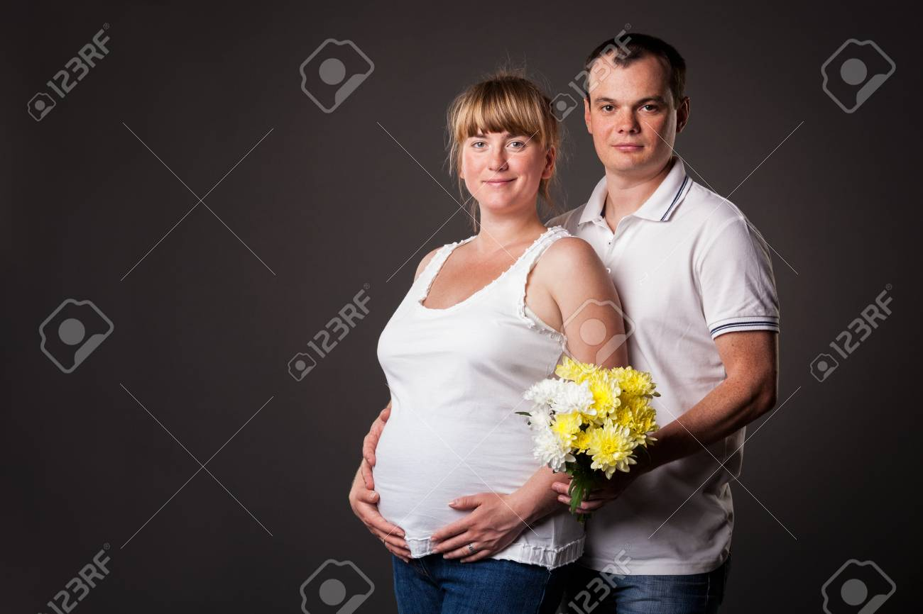 Portrait of young family together - studio shot Stock Photo - 15038435