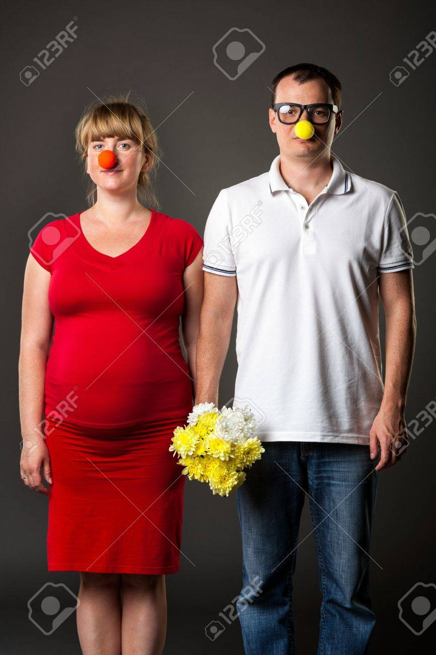 portrait of funny couple with funny noses and bunch of flowers