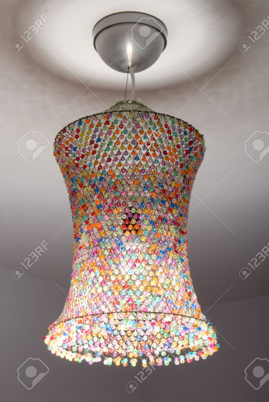A coloured lampshade is out of netting  and beads Stock Photo - 23827970