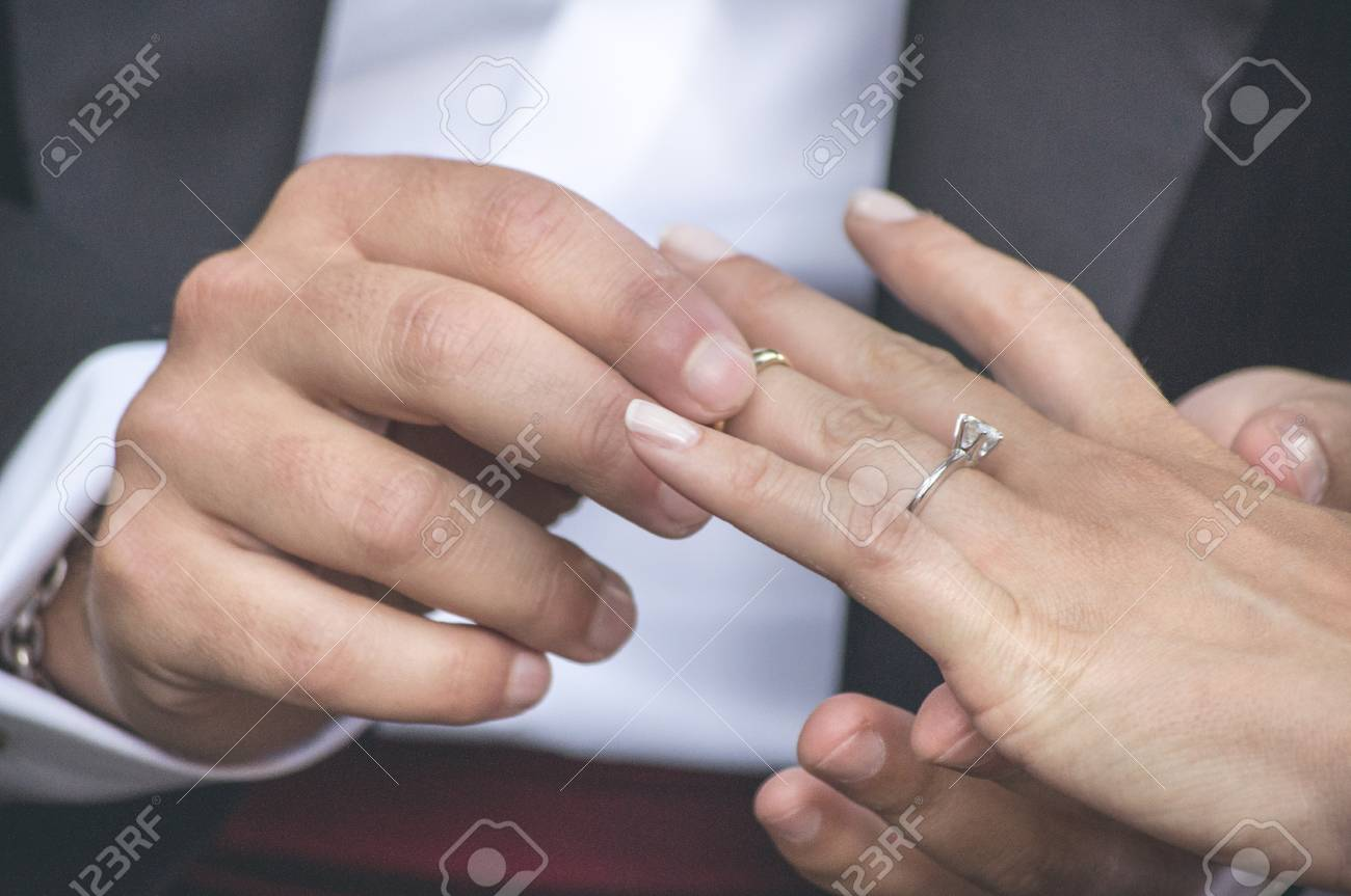 Hands Detail With Wedding Rings Exchange During A Wedding