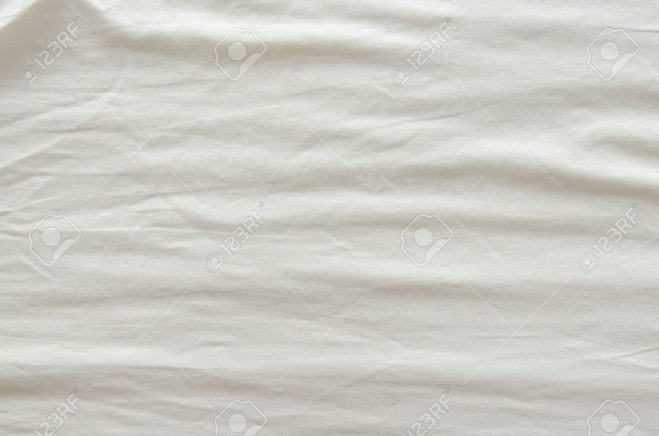 Wrinkled bed sheets texture - Stock Photo White Wrinkled Fabric Texture For Back Ground
