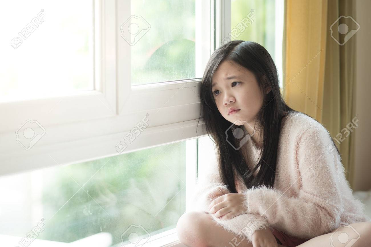 Portrait of asian beautiful sad girl at the window,vintage filter Stock Photo - 46996148
