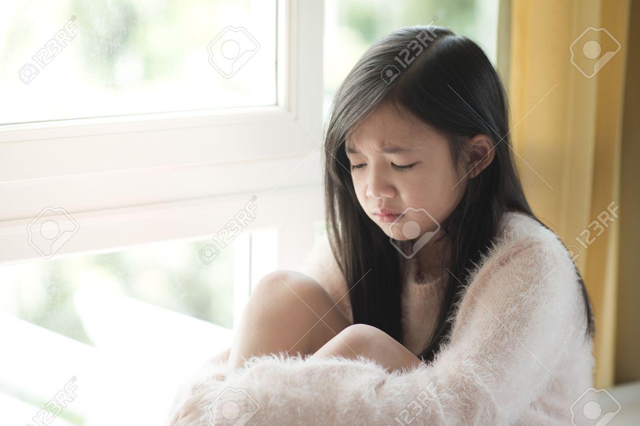 Portrait Of Asian Beautiful Sad Girl At The Windowvintage Filter Stock Photo