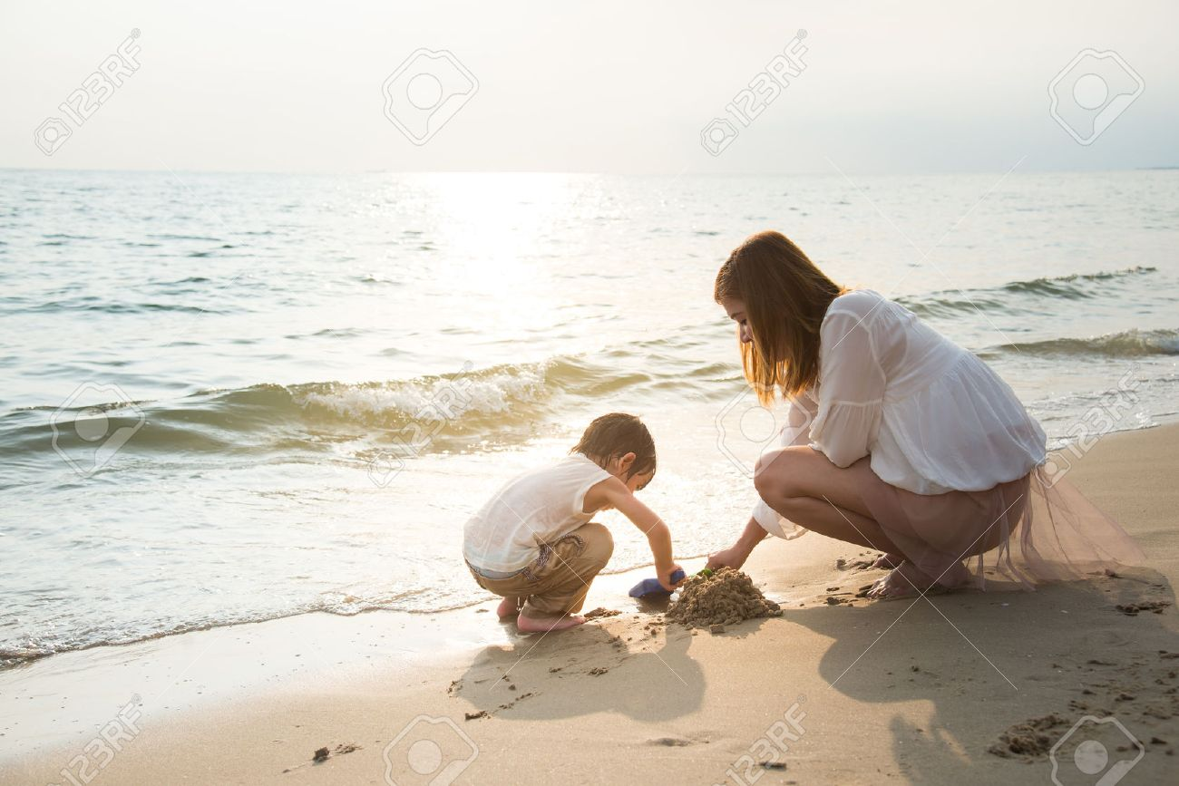mother and son playing on the beach,vintage filter Stock Photo - 47198631