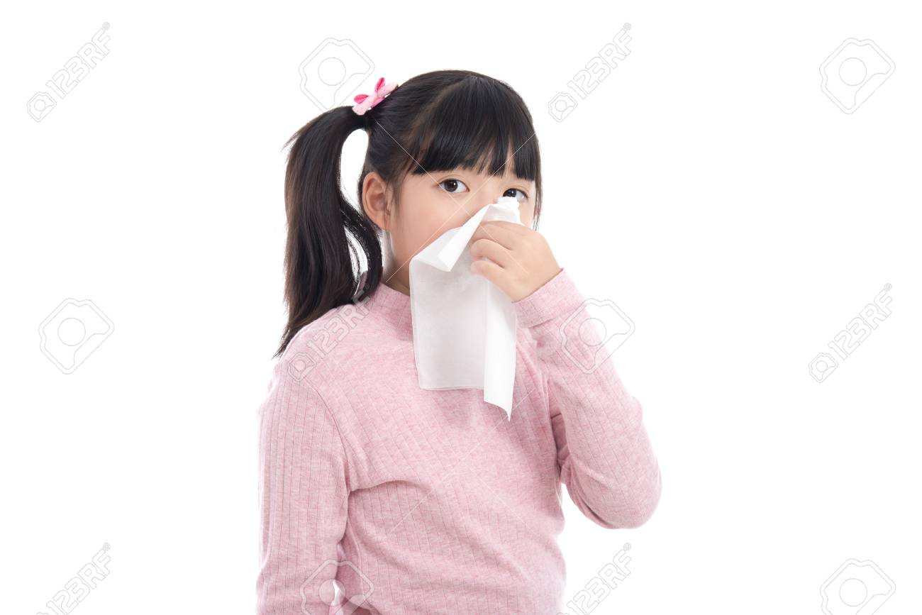 Beautiful Asian girl blows her nose on white background isolated Stock  Photo - 64199386