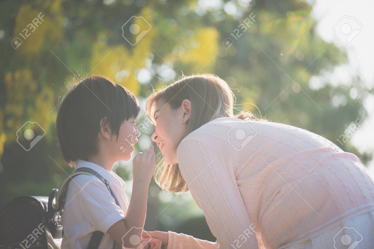 Asian child whispers something to his mother,back to school - 101362252
