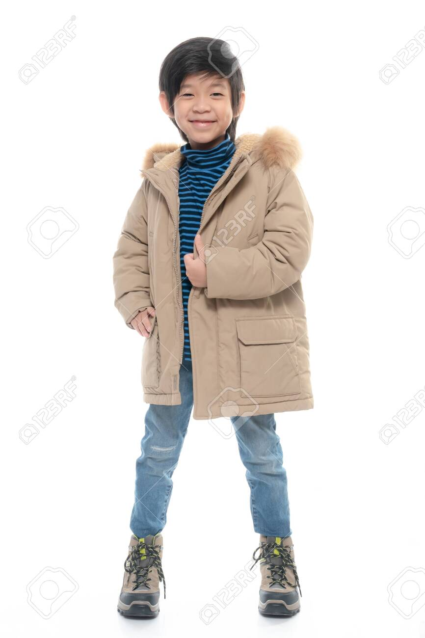 Cute Asian boy in warm clothing on white background.isolated - 136301877