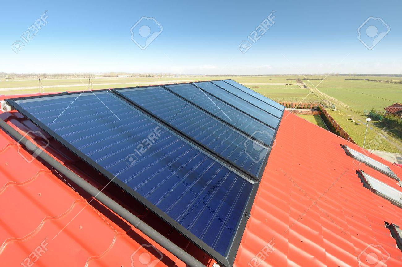 Closeup Of Solar Panels On Red Tiled Roof And Beautiful Blue.. Stock ...