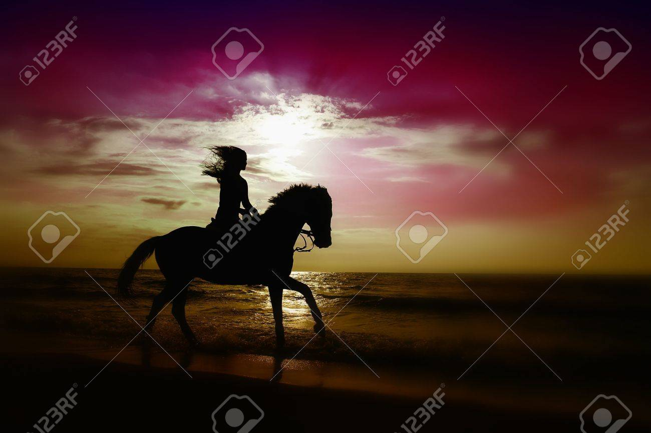 A girl riding a horse on the beach at sun set time. Stock Photo - 6257347