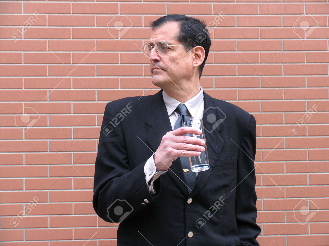 Outstanding businessman drinking water Stock Photo - 834989