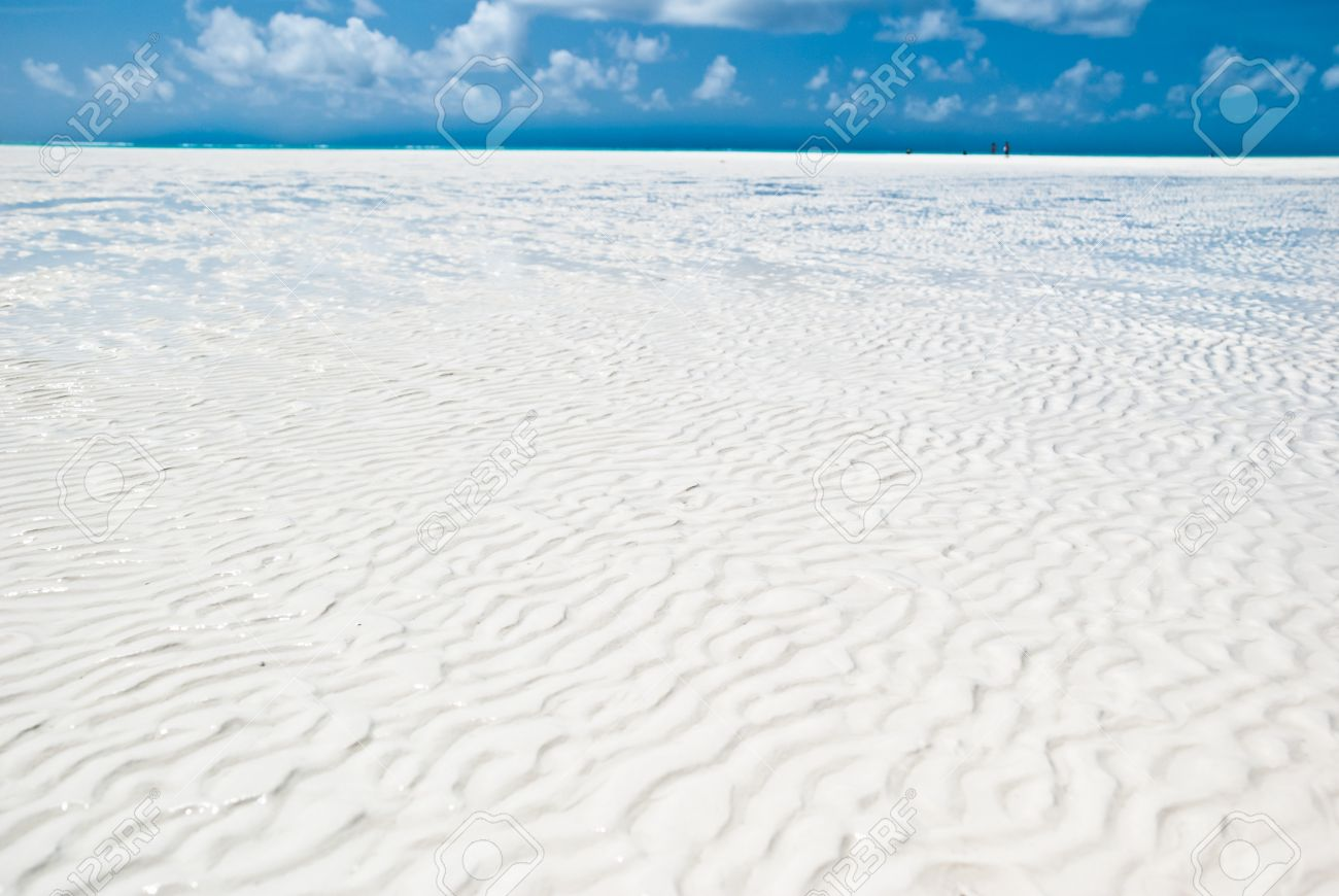 Texture Of The White Sand In A Beach Zanzibar During Low Tide Stock Photo
