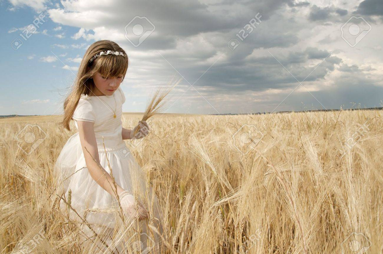 girl wearing first communion dress among the spikes Stock Photo - 10082265