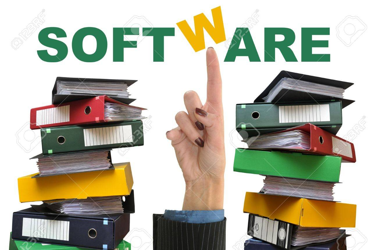 Businesswoman hand pointing the word software with old files around Stock Photo - 5727255