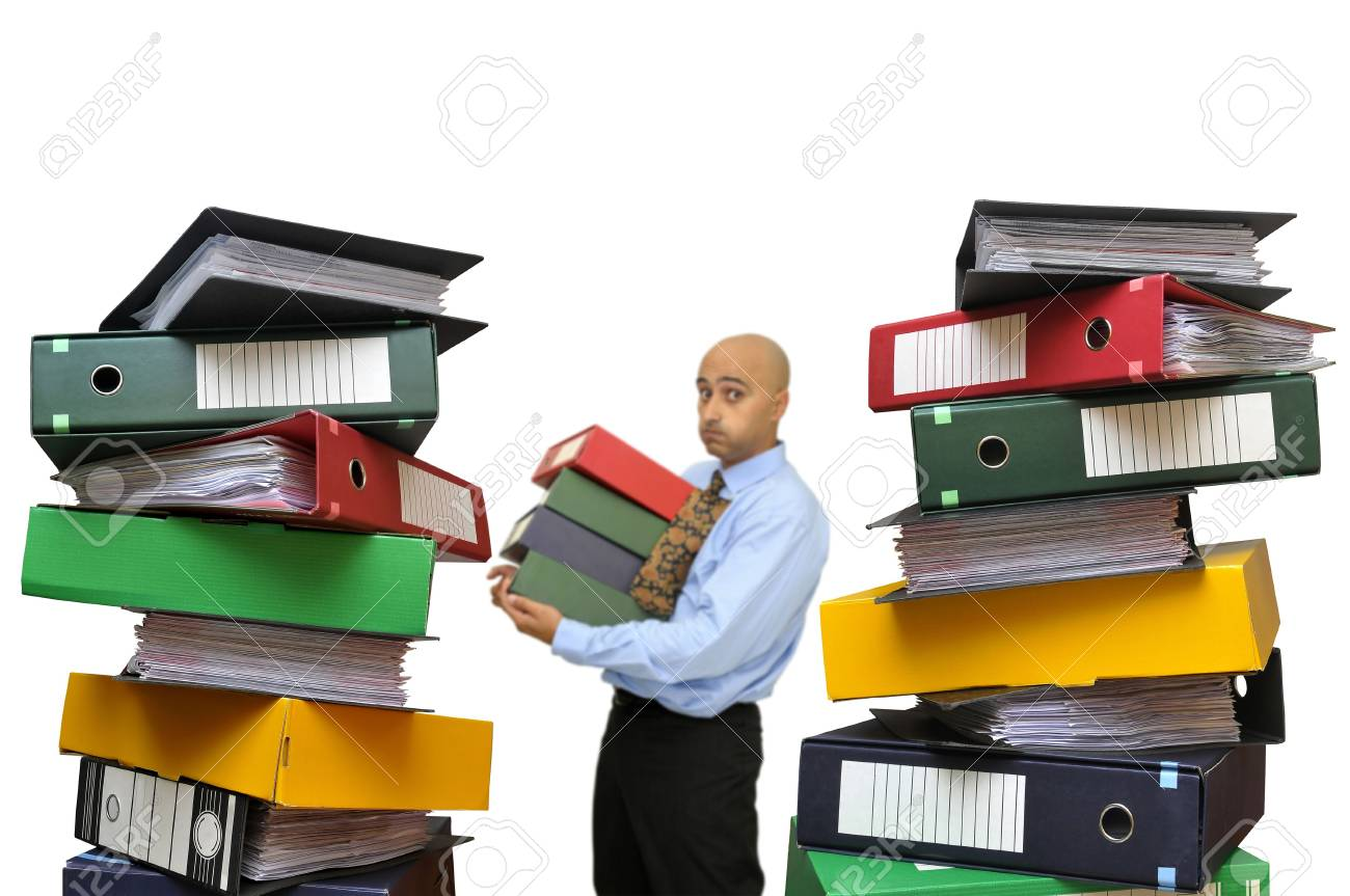Businessman with a big pile of files isolated in white Stock Photo - 5976635