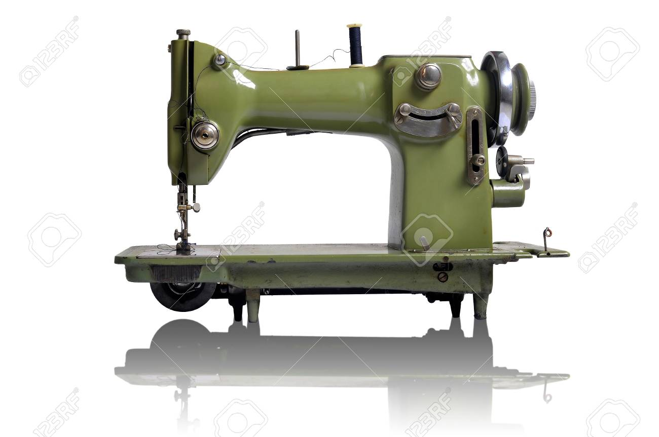 Old sewing machine isolated in white Stock Photo - 6944374