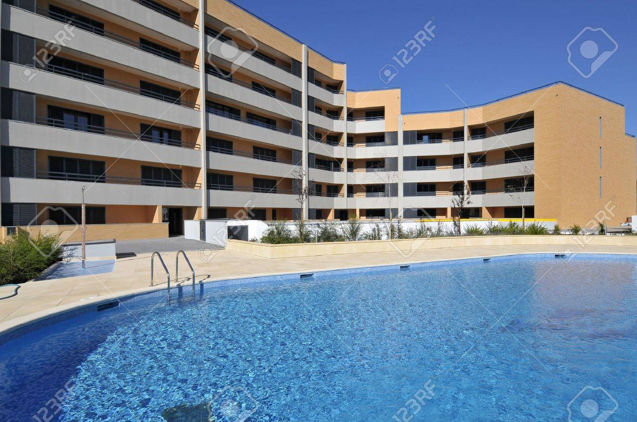 Modern apartments outdoors view with swimming pool Stock Photo - 8103625
