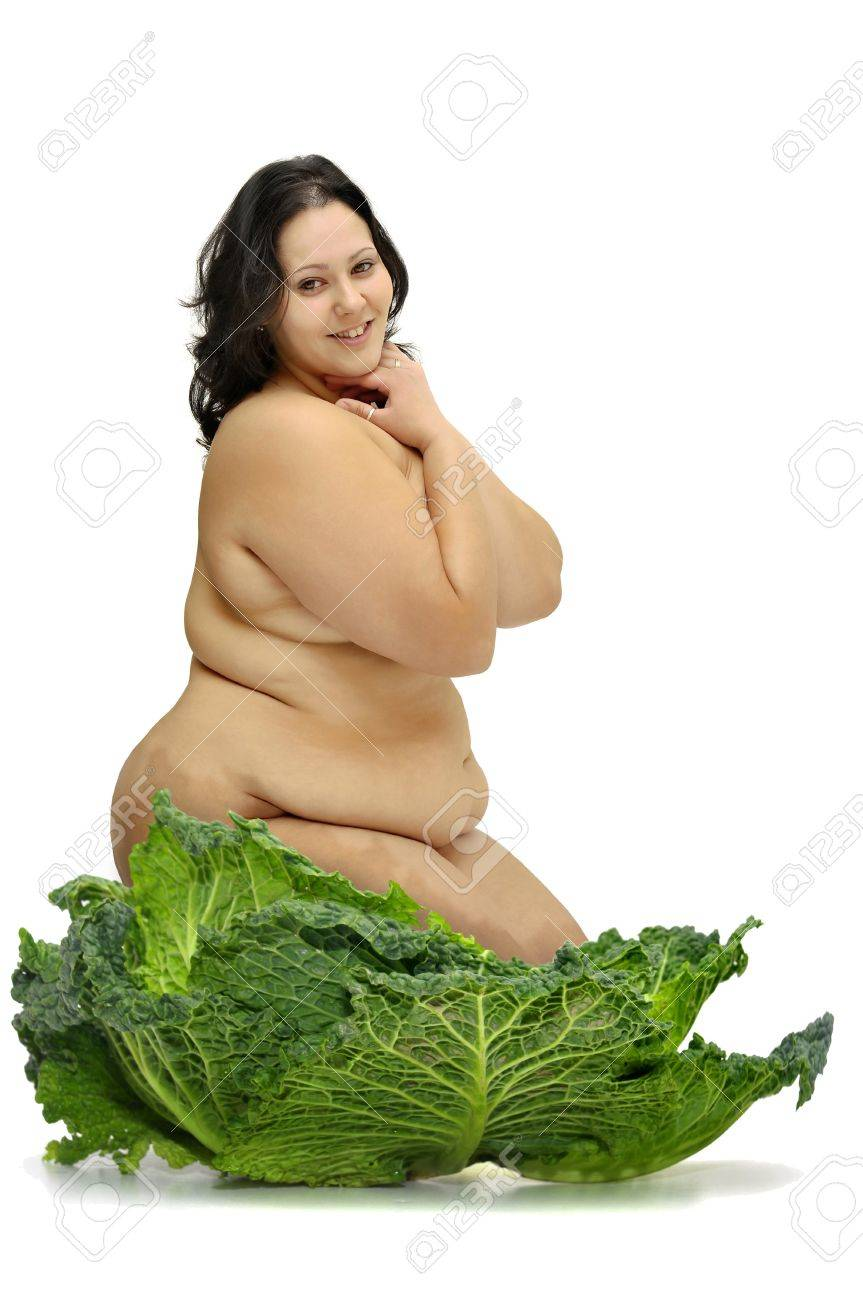 Beautiful large girl with vegetables isolated in white Stock Photo - 11149351
