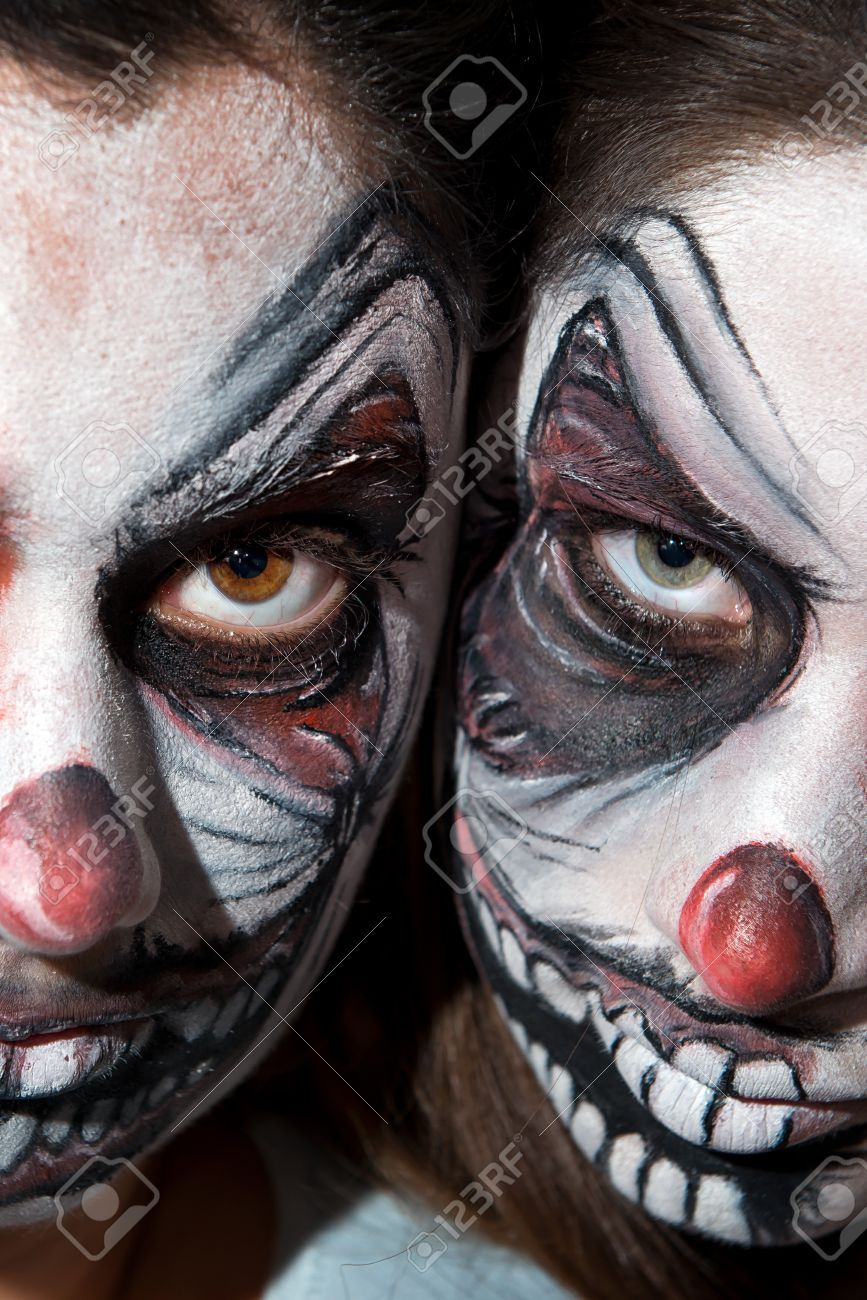 stock photo teenage girls with scary clown face painting