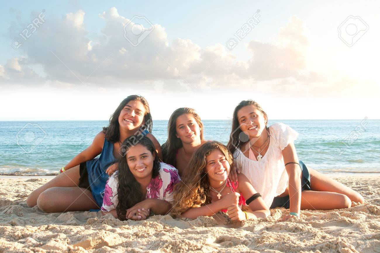 Group of happy teen girls at the beach Stock Photo - 54882769
