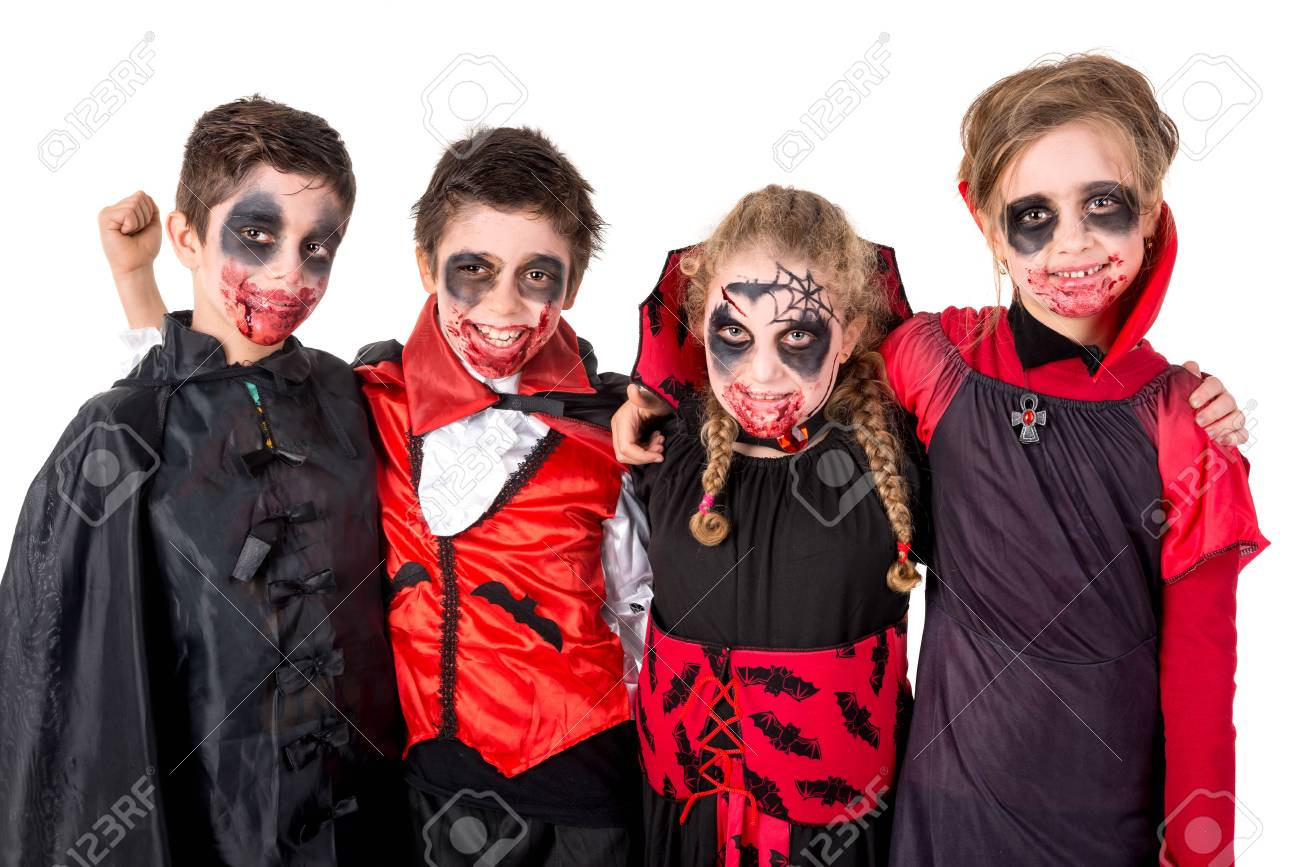 Group of kids with face,paint and Halloween vampire costumes
