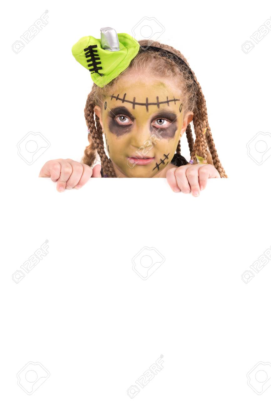 girl with face-paint and halloween monster costume over a white