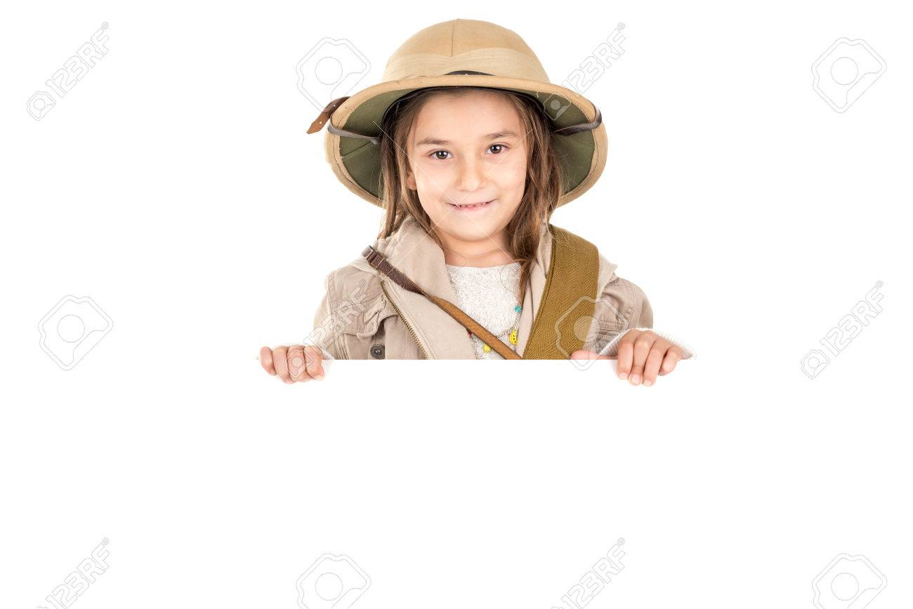 5c5e3b44ad261 Stock Photo - Young girl with Safari clothes behind a white board isolated  in white