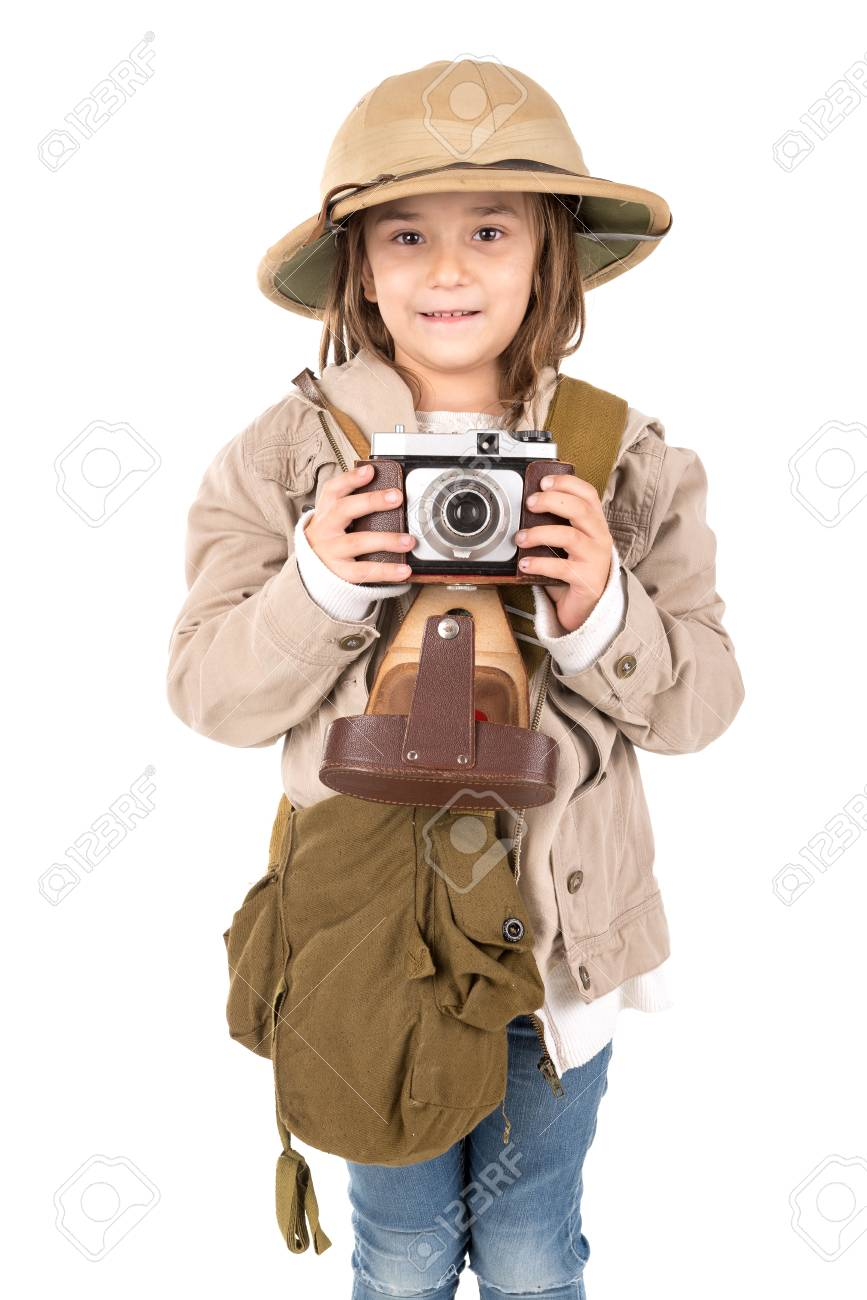 12637f6e26747 Stock Photo - Young girl with a camera playing Safari isolated in white