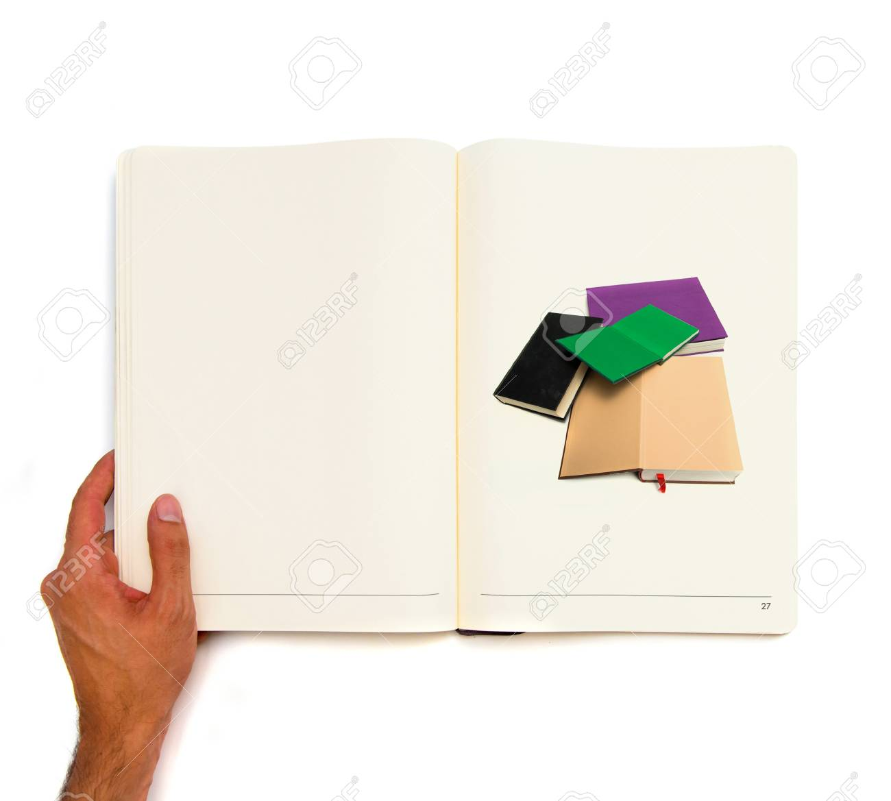 Hand holding white book with several books inside Stock Photo - 22141305