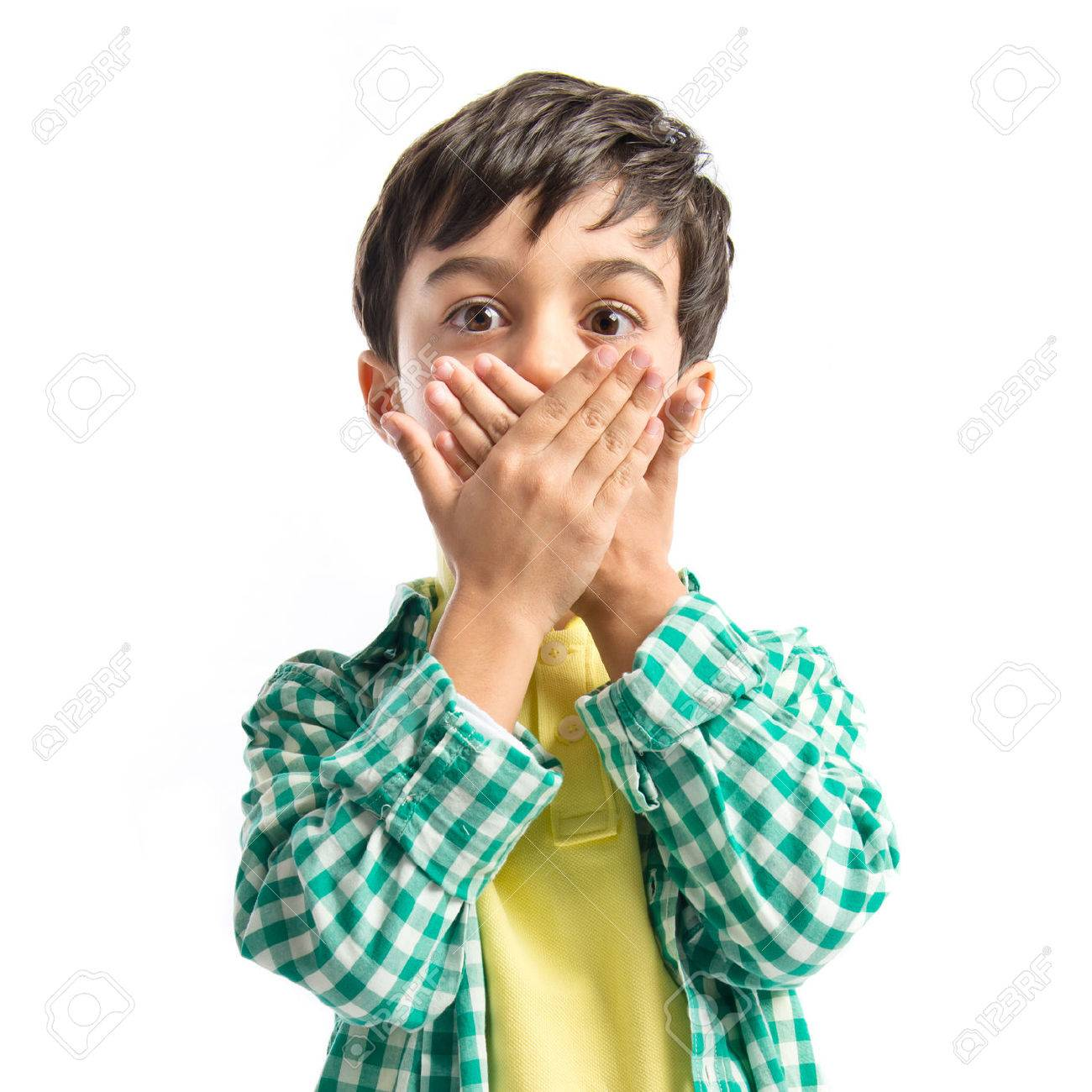 Kid covering his mouth over white background Stock Photo - 28676602