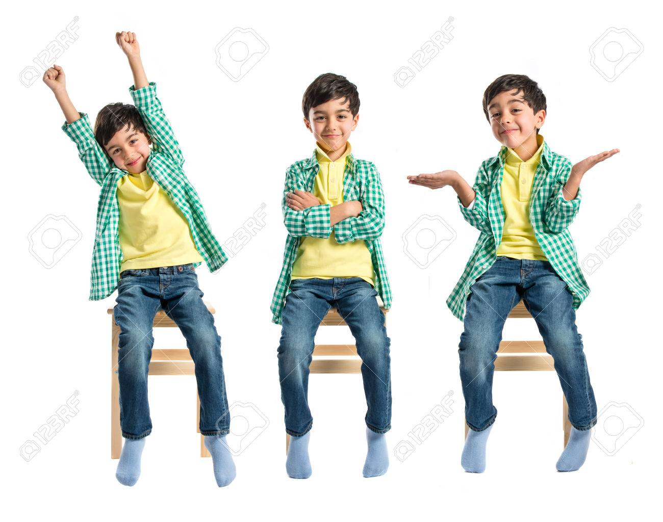 Happy brunette kid on wooden chair over white Stock Photo - 28676625