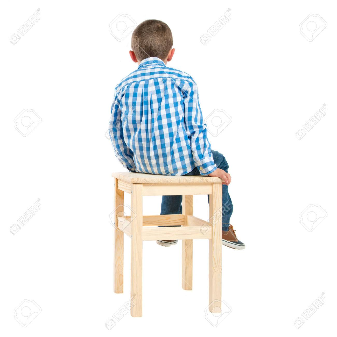 back kid on wooden chair over white background - 29891749