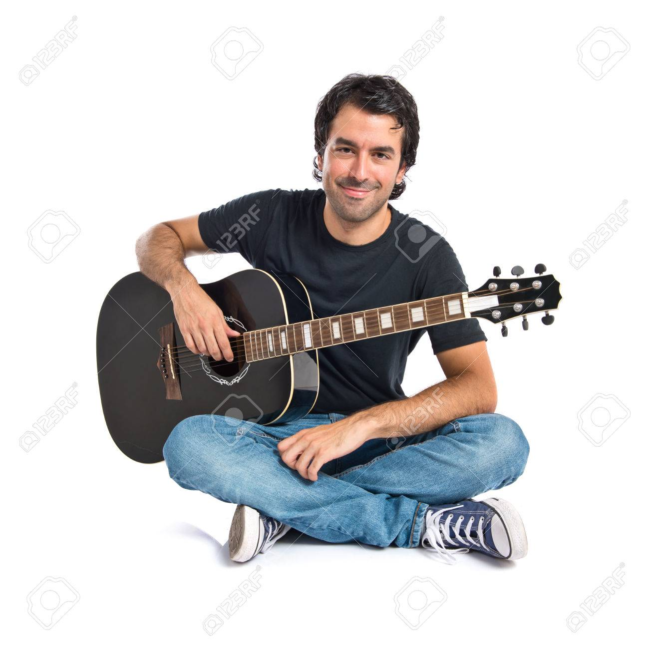 Handsome man with guitar over white background - 32492242
