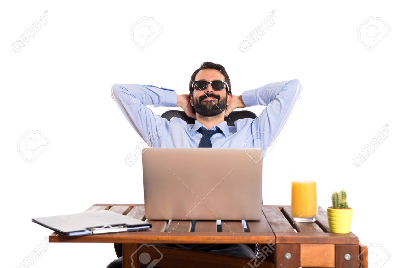 Businessman in his office with sunglasses - 33608884